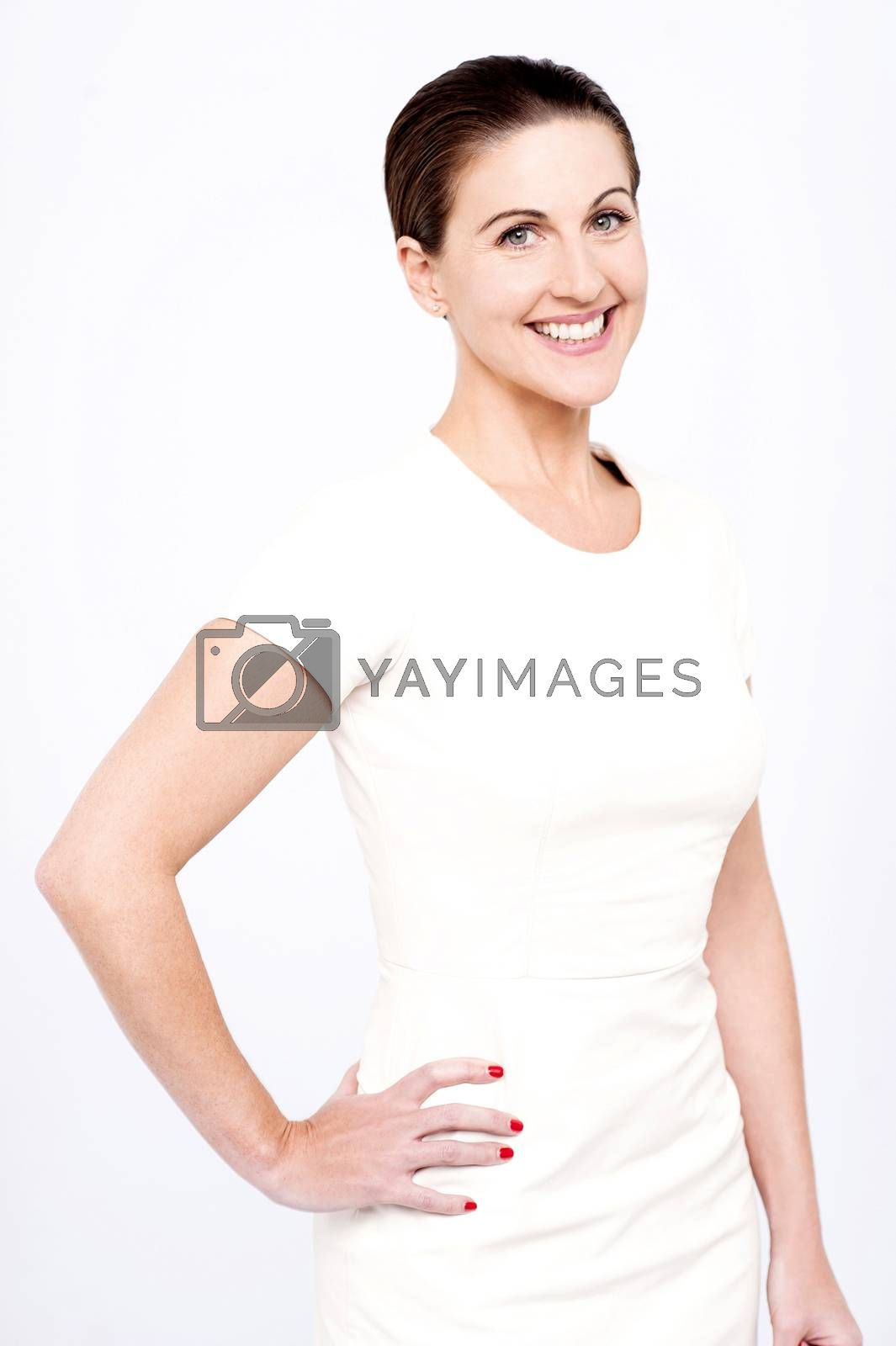 Stylish woman posing with hands on her hips