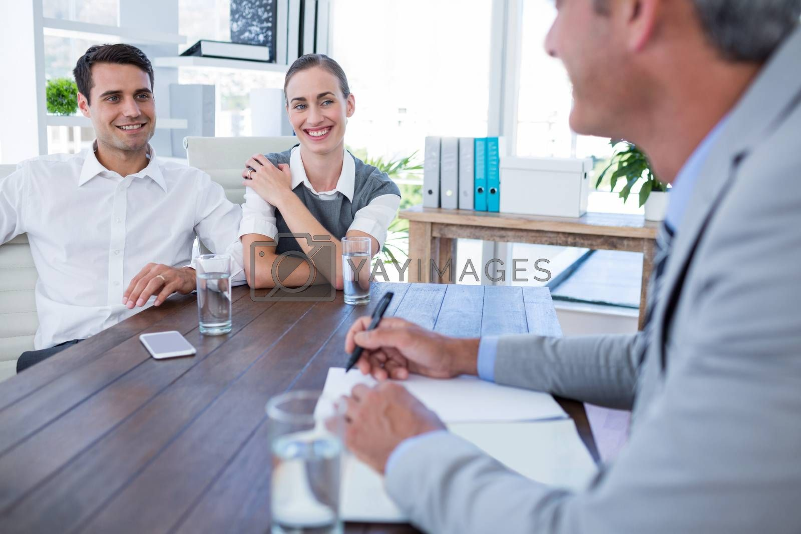 Casual business people speaking together in office