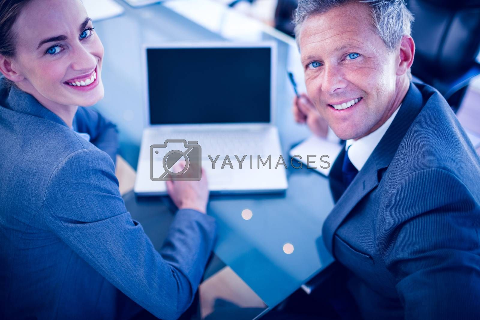 Royalty free image of Happy business people looking at camera  by Wavebreakmedia