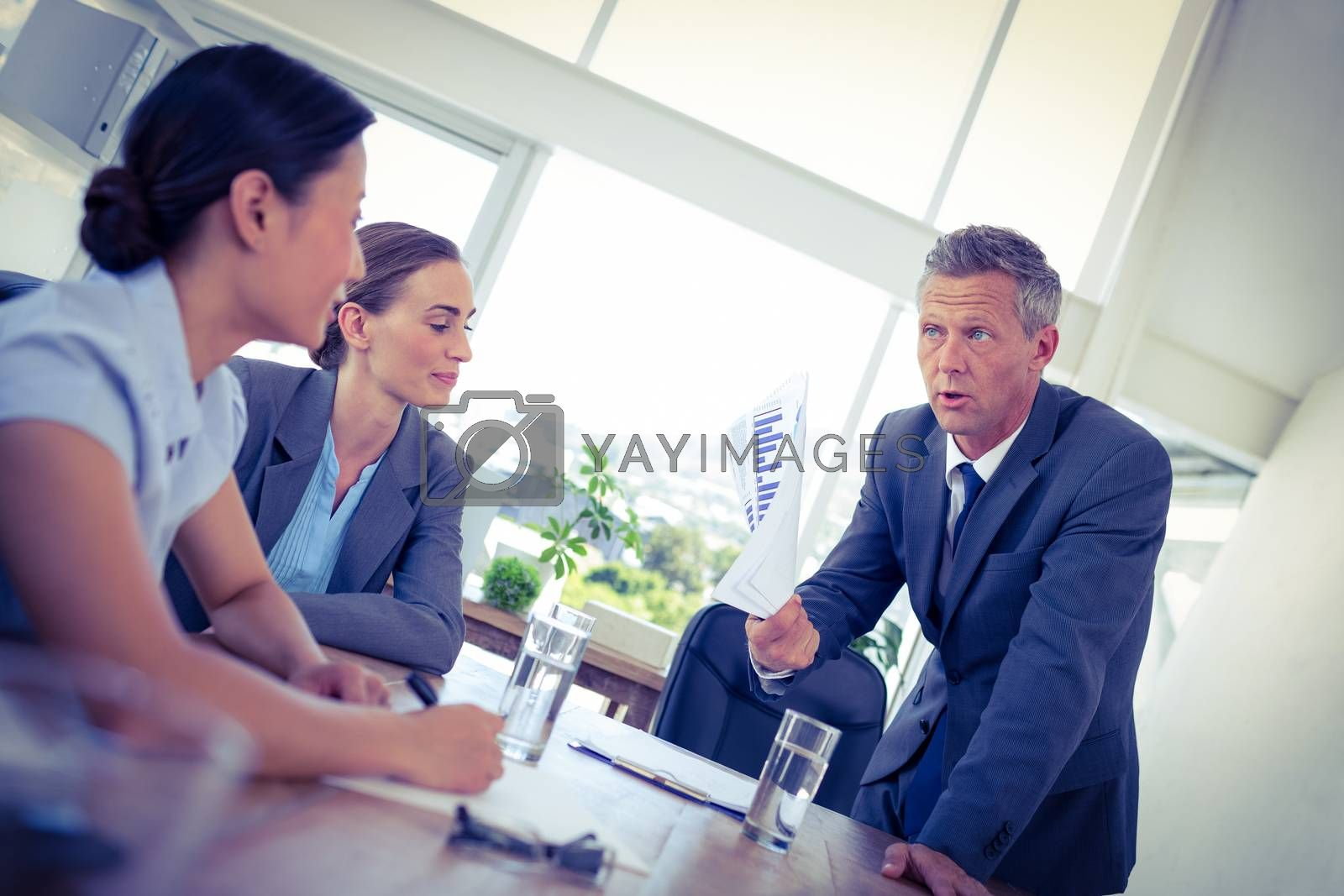 Royalty free image of Businessman showing documents during meeting by Wavebreakmedia