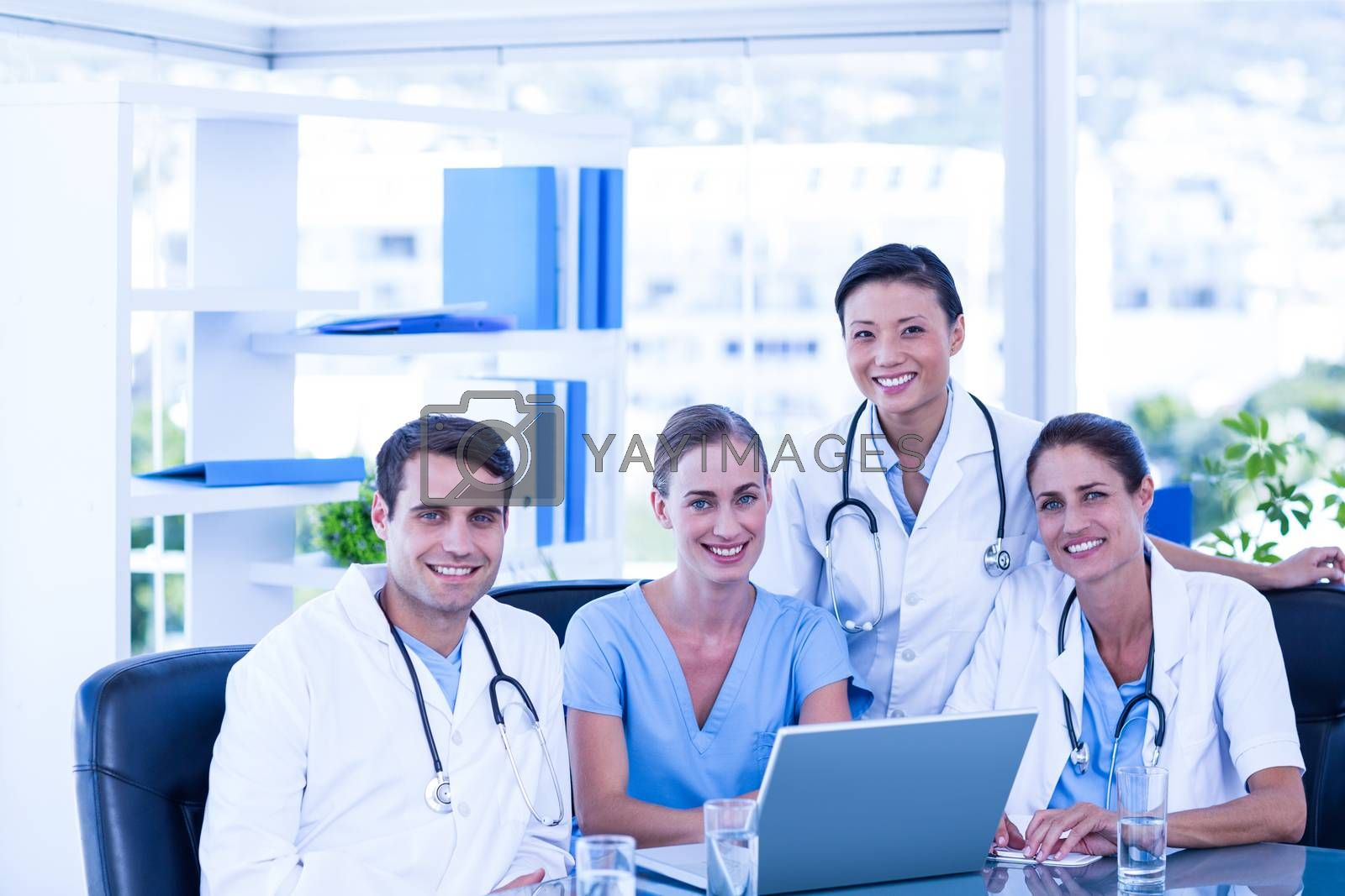 Royalty free image of Team of doctors smiling at camera by Wavebreakmedia