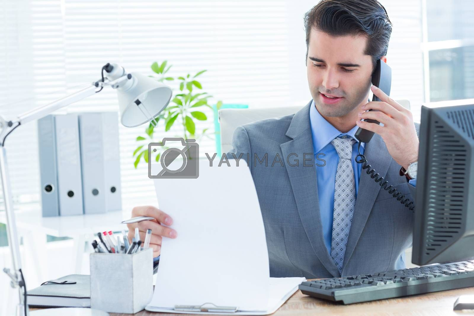 Royalty free image of Professional businessman checking at his notebook by Wavebreakmedia