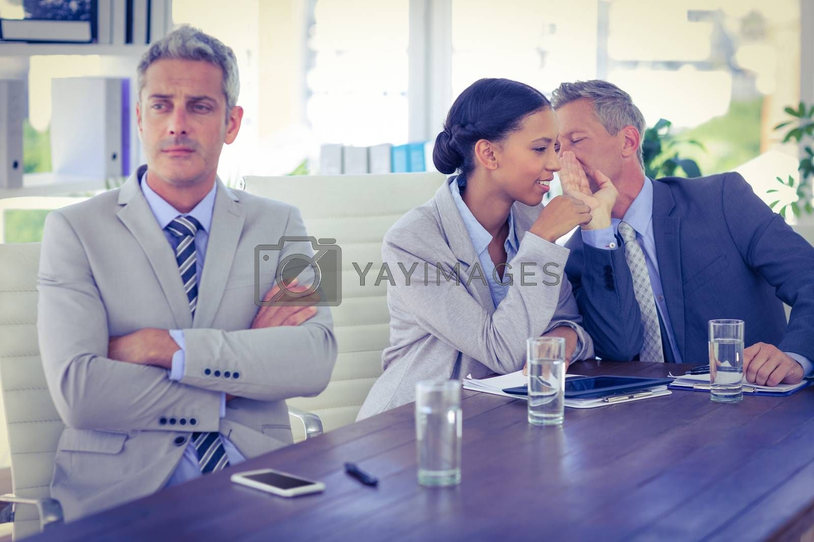 Royalty free image of Sad businessman looking aways while his colleagues speaks   by Wavebreakmedia