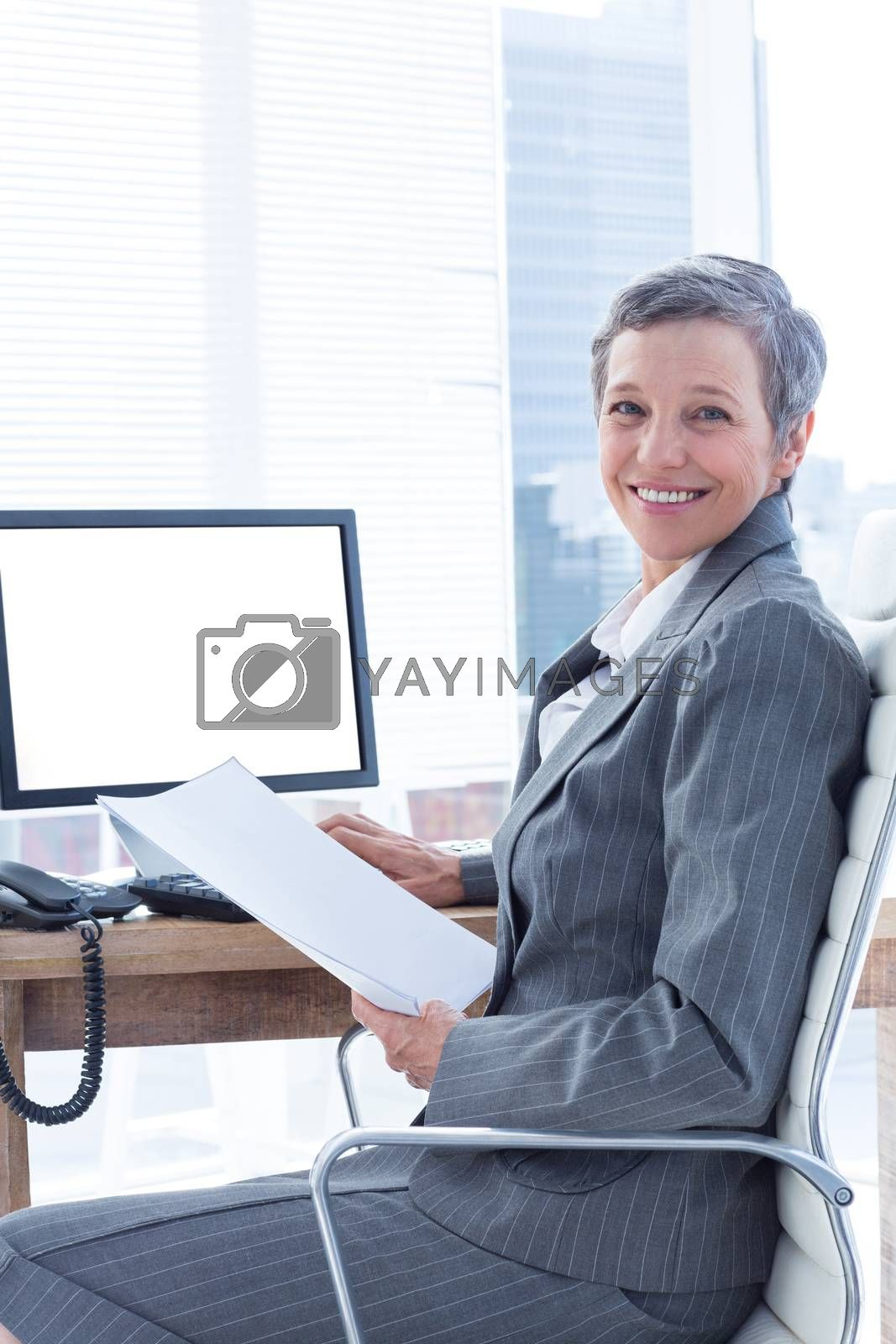 Royalty free image of Smiling businesswoman using computer  by Wavebreakmedia