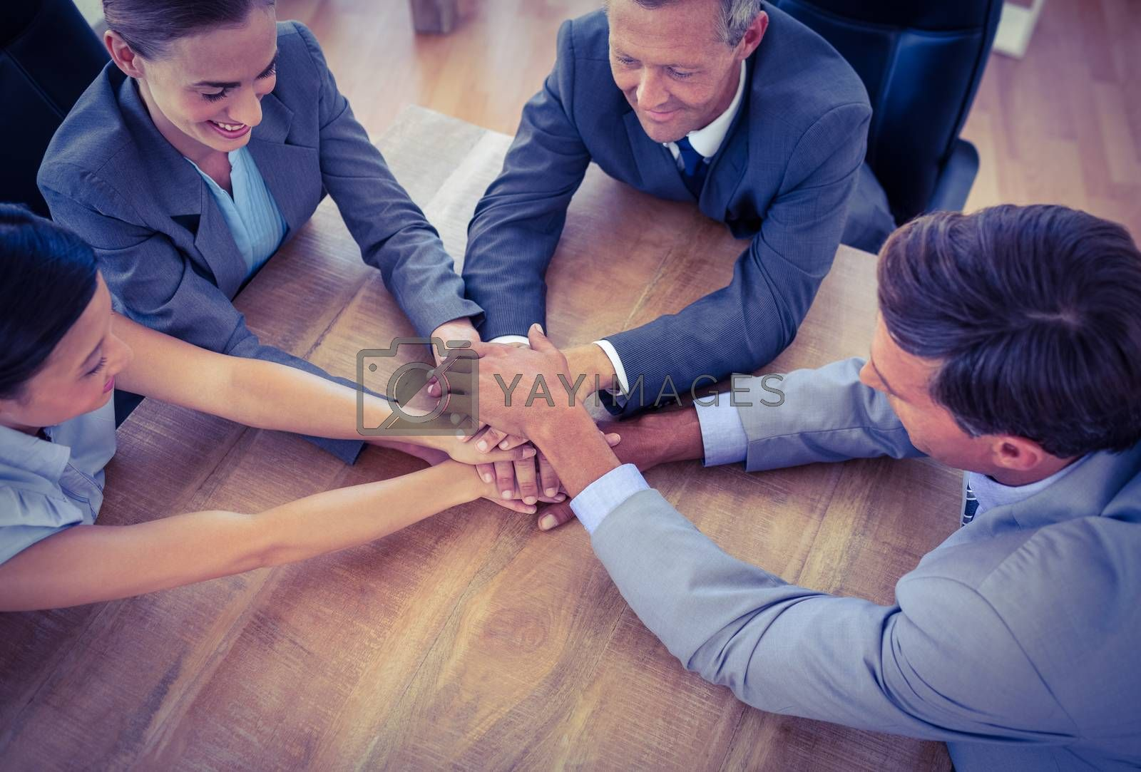 Royalty free image of Business people joining hands in a circle by Wavebreakmedia