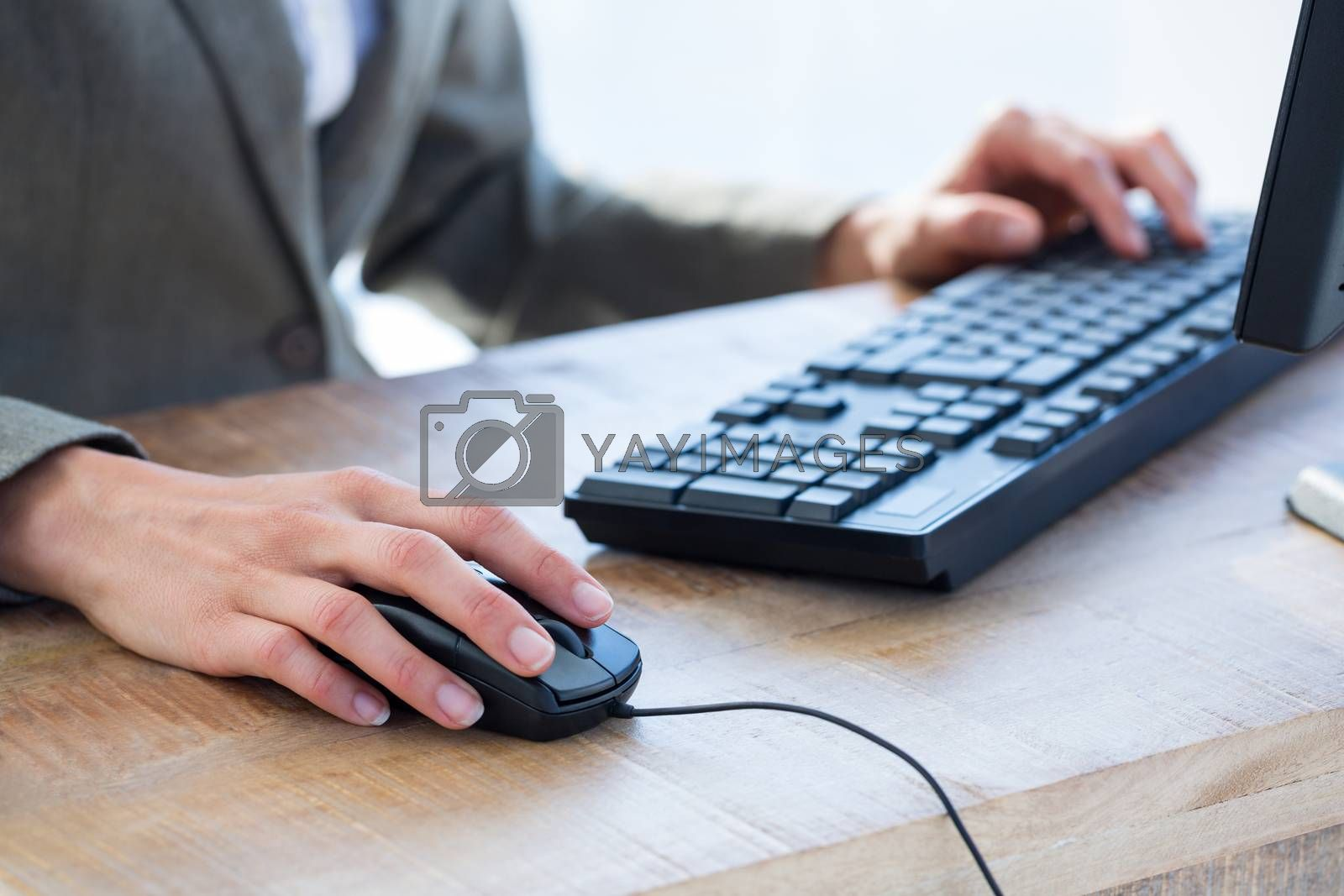 Royalty free image of A businessman using his computer  by Wavebreakmedia