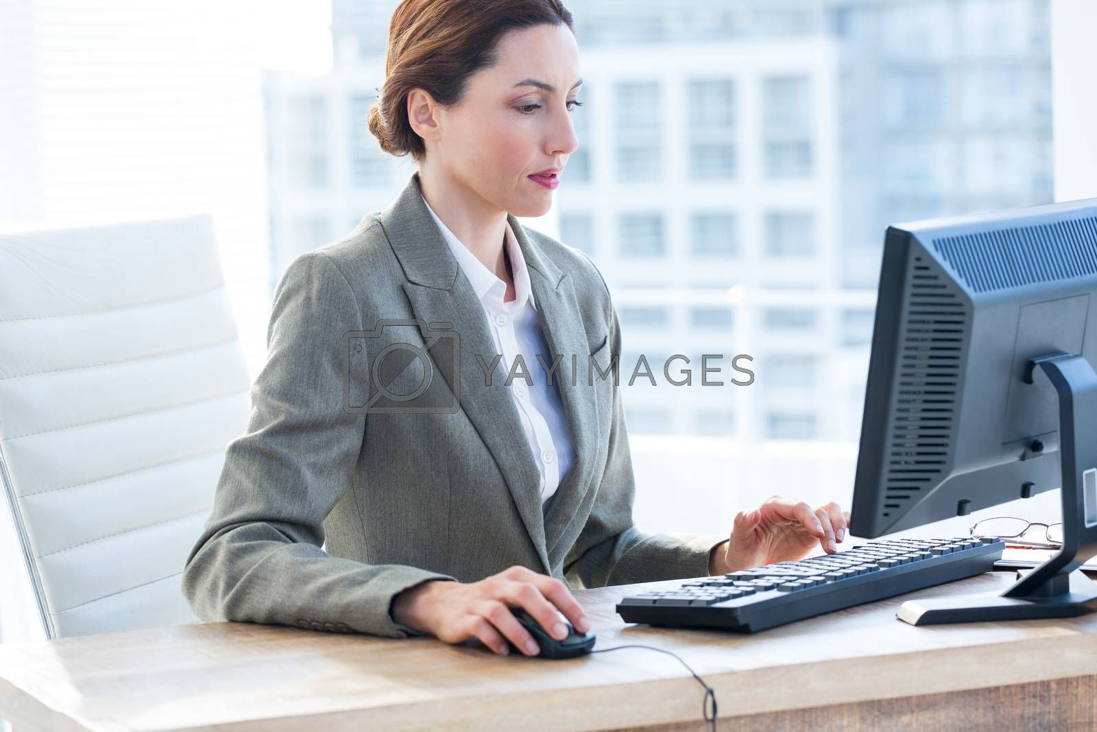 Royalty free image of Businesswoman using his computer  by Wavebreakmedia