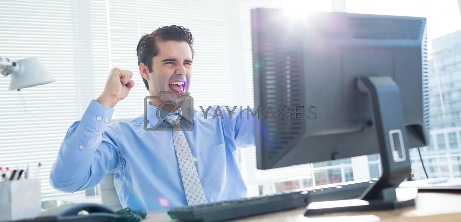 Royalty free image of Cheerful businessman cheering in office by Wavebreakmedia