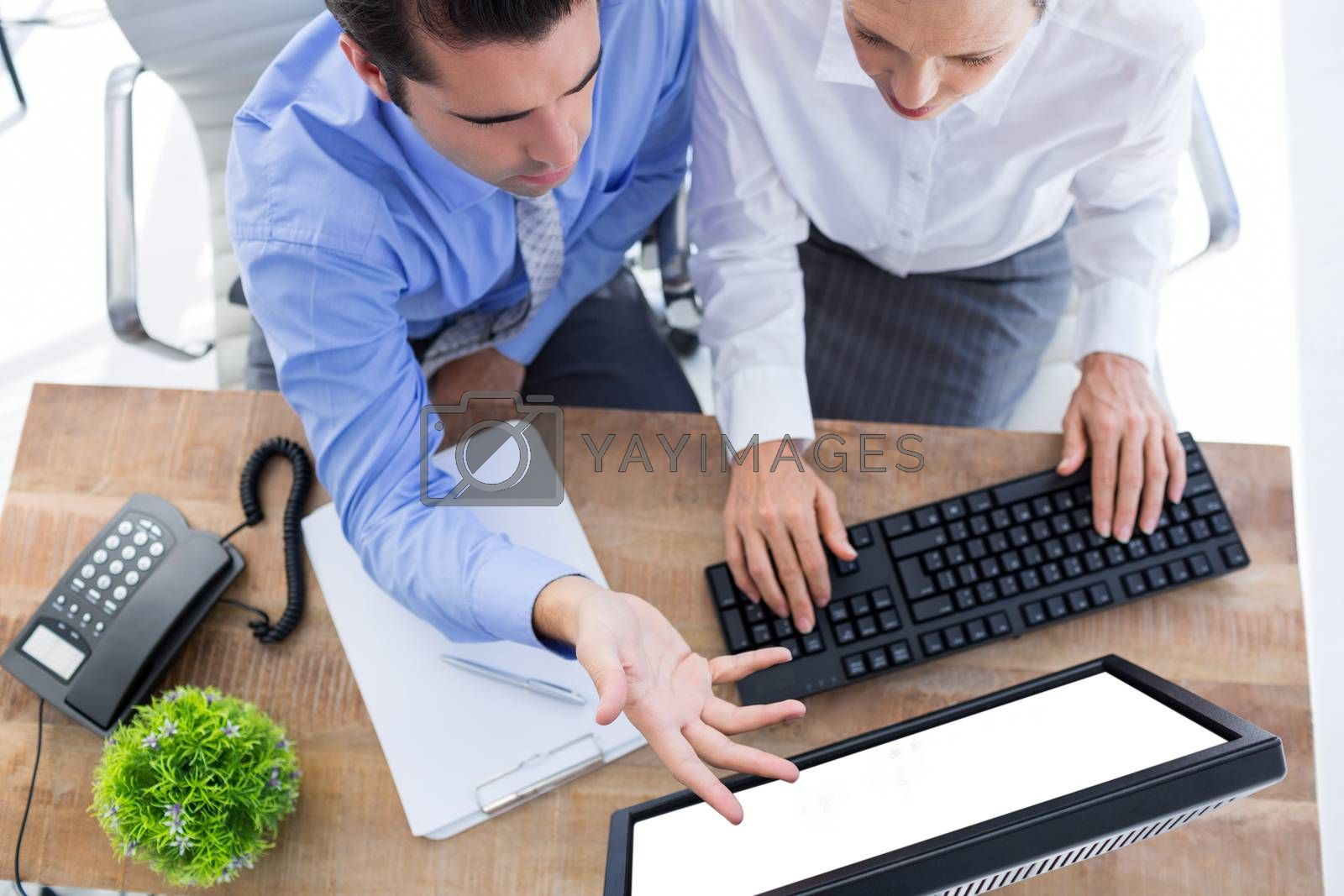 Royalty free image of Coworker working with a laptop by Wavebreakmedia