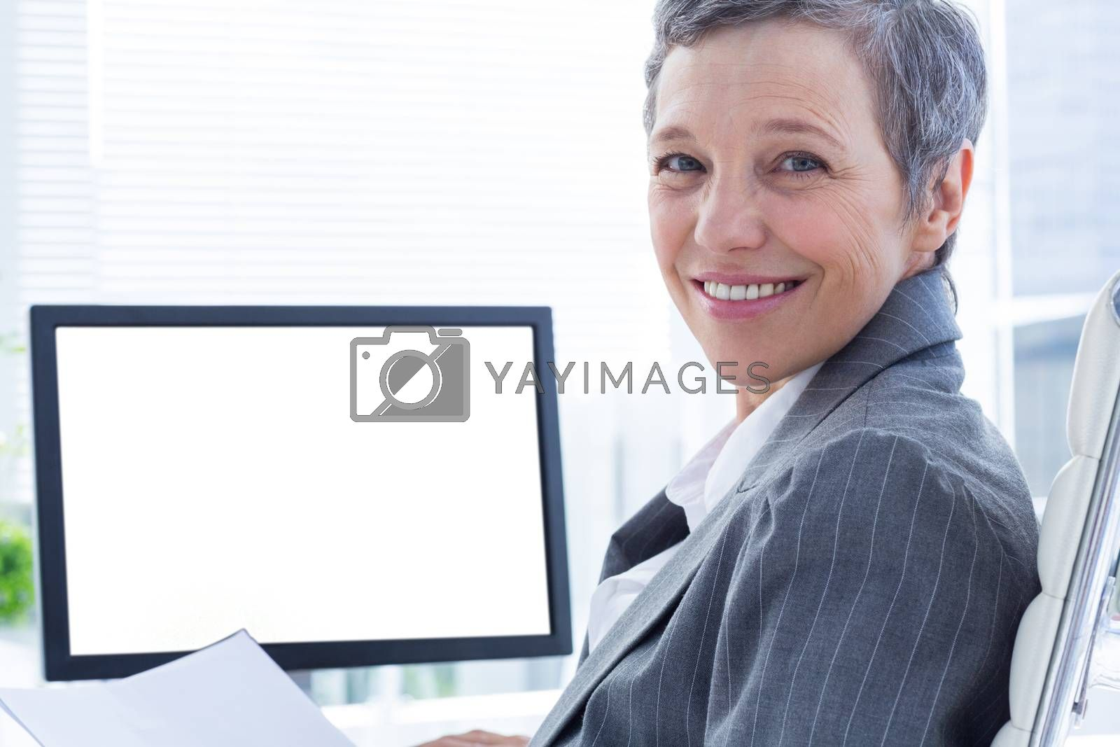 Royalty free image of Portrait of smiling businsswoman using computer by Wavebreakmedia