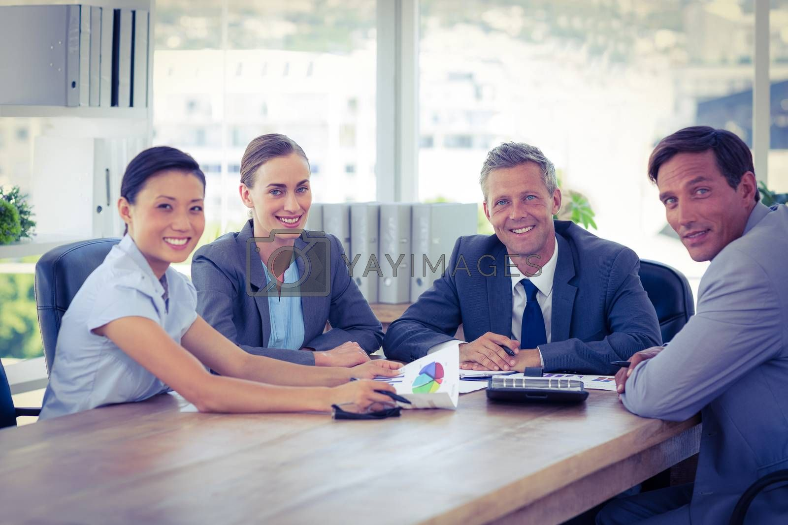 Royalty free image of Business people looking at camera during meeting  by Wavebreakmedia