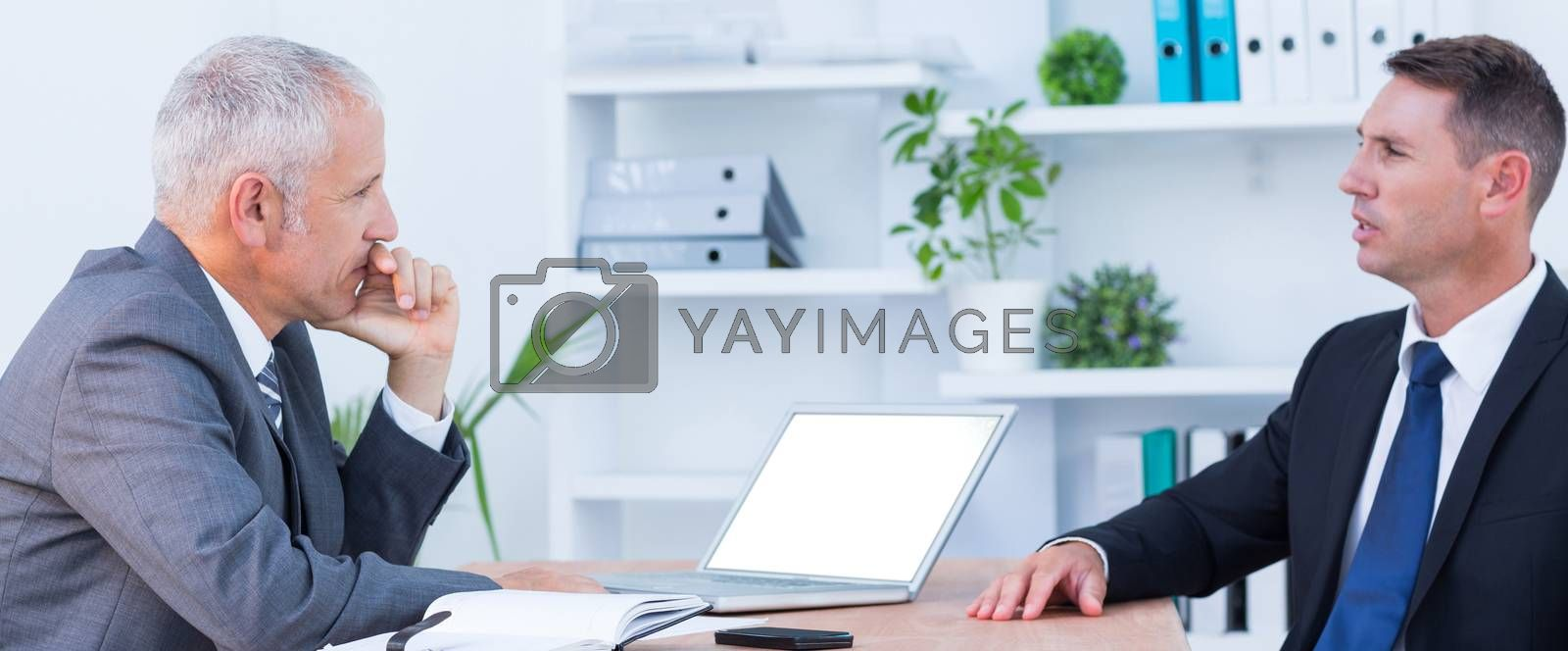 Royalty free image of Two businessmen speaking and working  by Wavebreakmedia