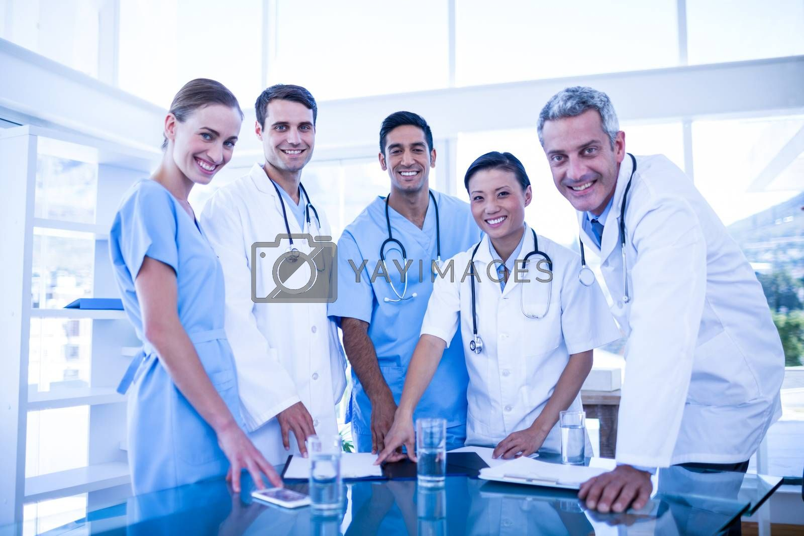 Royalty free image of Doctors and nurses smiling at camera by Wavebreakmedia