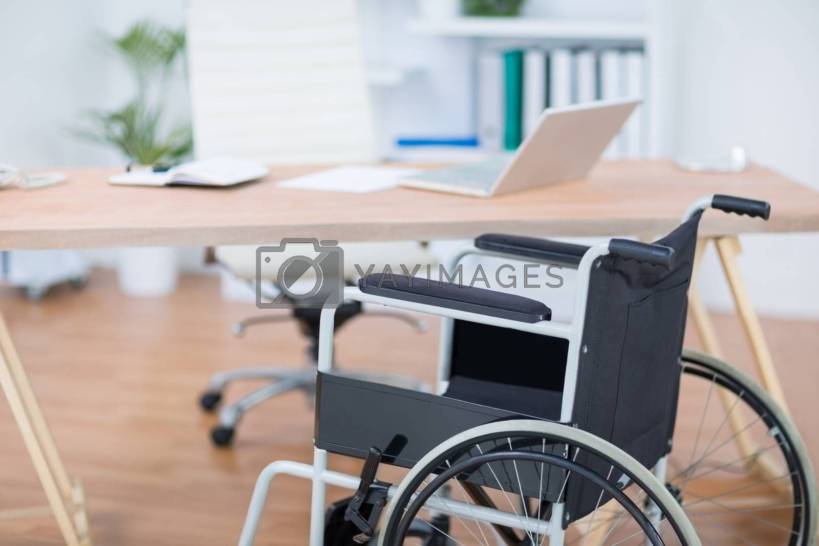 Royalty free image of A free wheelchair at his desk  by Wavebreakmedia