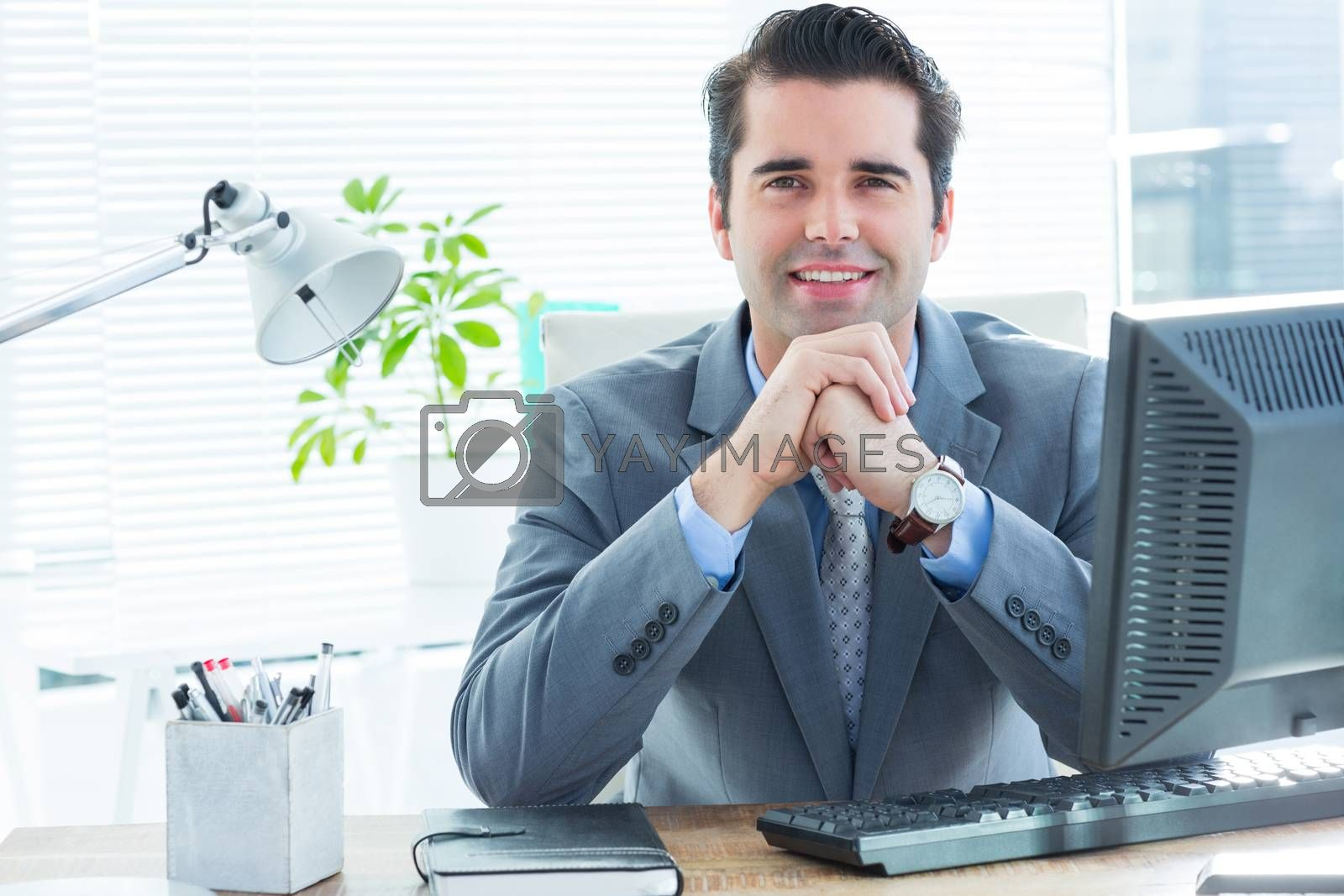 Royalty free image of Professional businessman looking at the camera by Wavebreakmedia