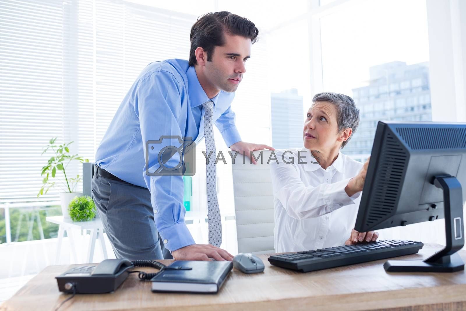 Royalty free image of Business people working together on laptop by Wavebreakmedia