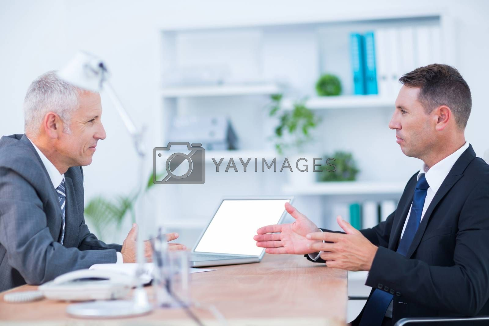 Royalty free image of Two serious businessmen speaking and working  by Wavebreakmedia