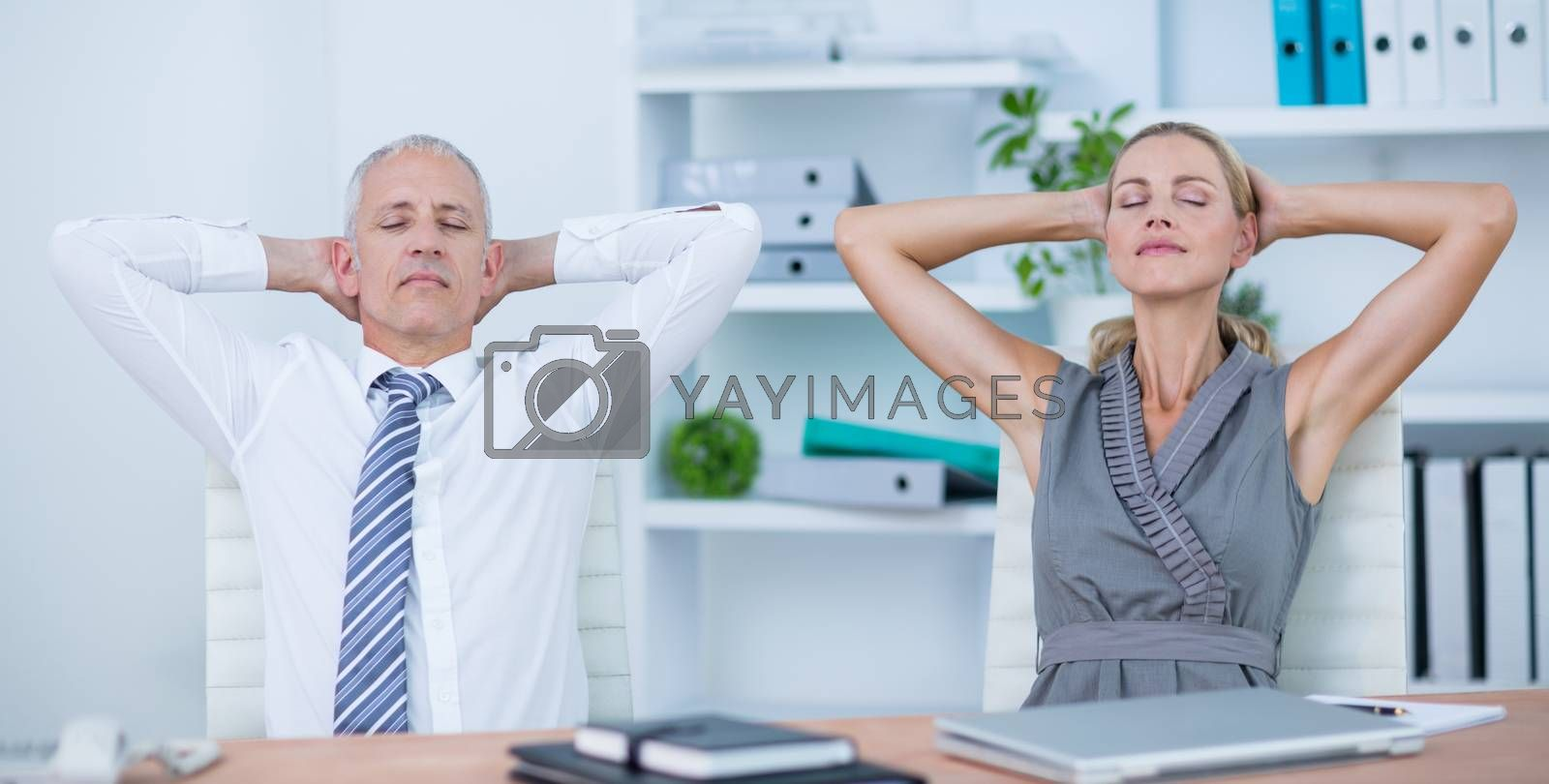 Royalty free image of Business people relaxing in swivel chairs by Wavebreakmedia