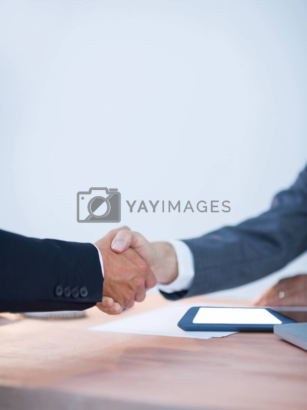 Royalty free image of Two colleagues buinessmen shaking hands by Wavebreakmedia