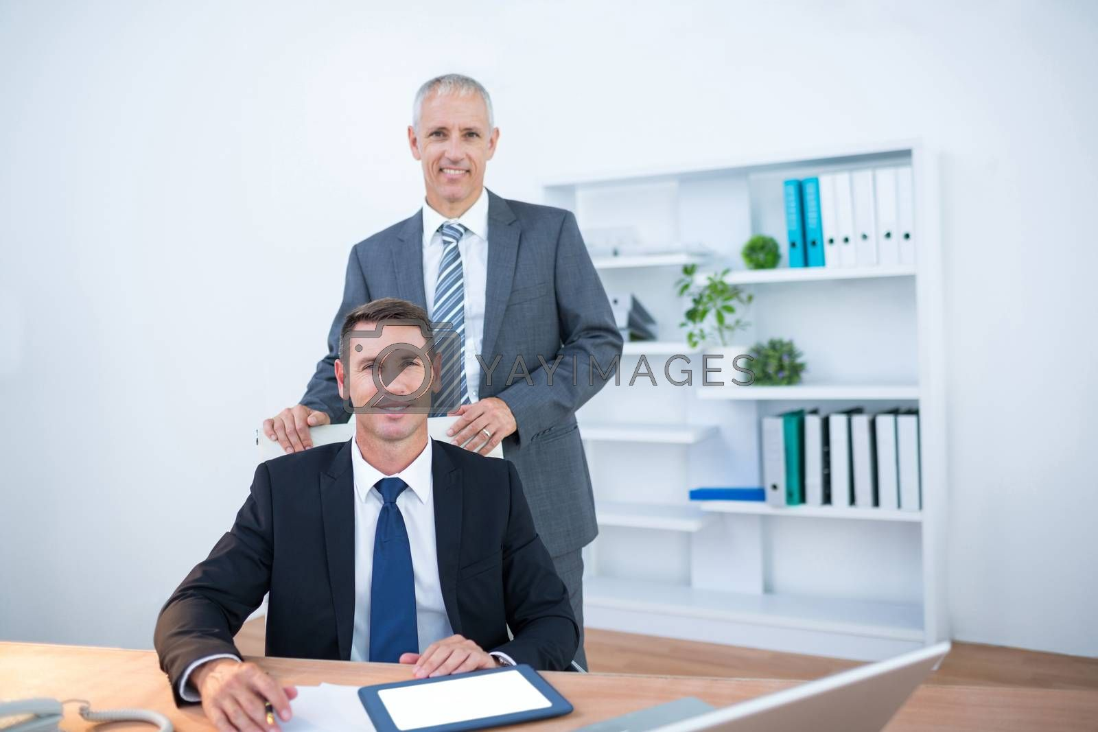 Royalty free image of Happy colleagues working together on digital tablet  by Wavebreakmedia
