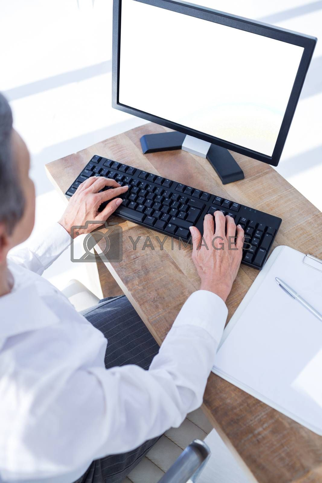 Royalty free image of A businesswoman using her computer by Wavebreakmedia