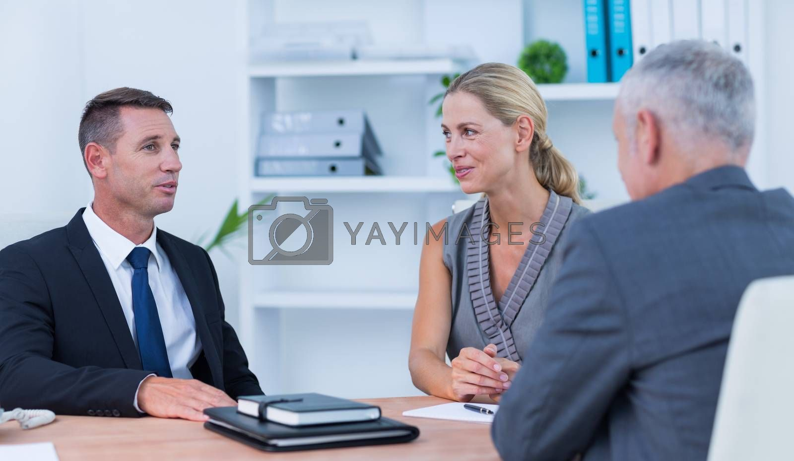 Royalty free image of Happy business people in meeting by Wavebreakmedia