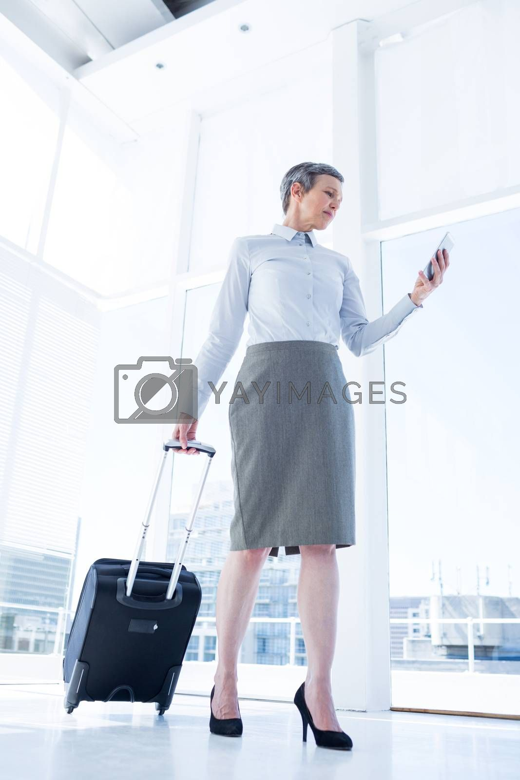 Royalty free image of Businesswoman holding smartphone in the office by Wavebreakmedia