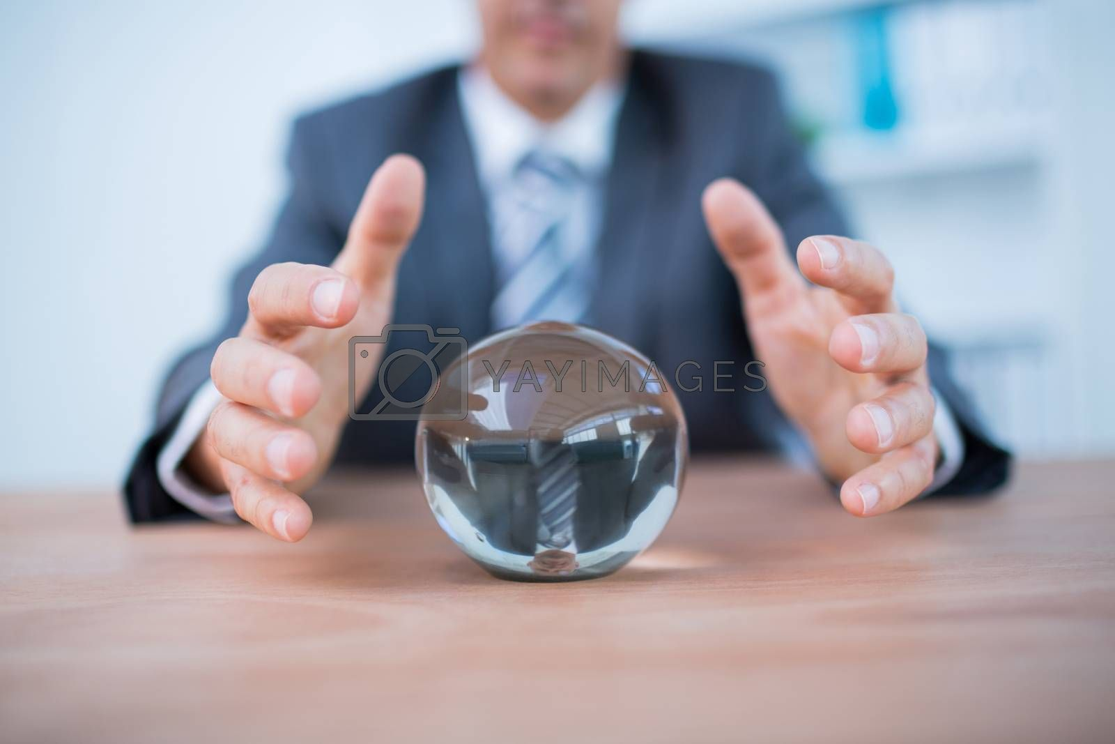 Royalty free image of Businessman forecasting a crystal ball by Wavebreakmedia