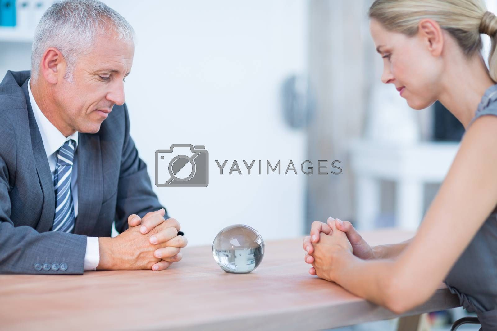 Royalty free image of Two business people thinking with a crystal ball  by Wavebreakmedia