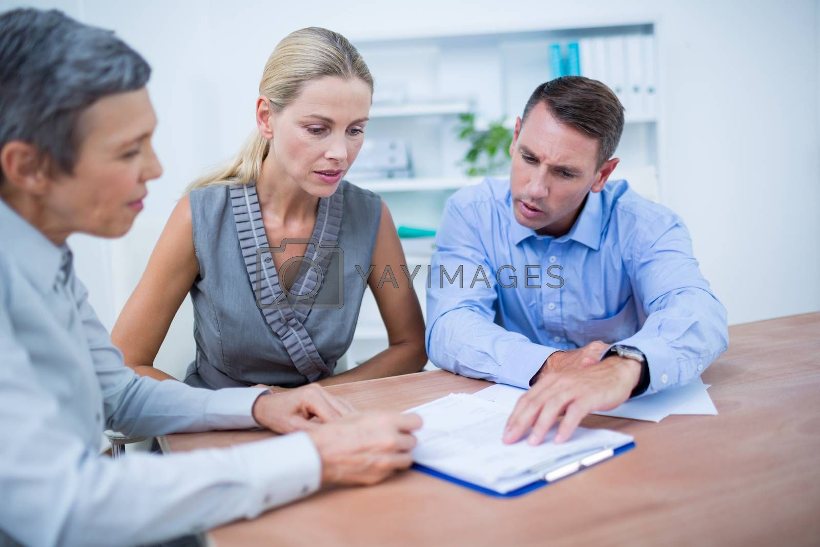 Royalty free image of A business team brainstorming together by Wavebreakmedia