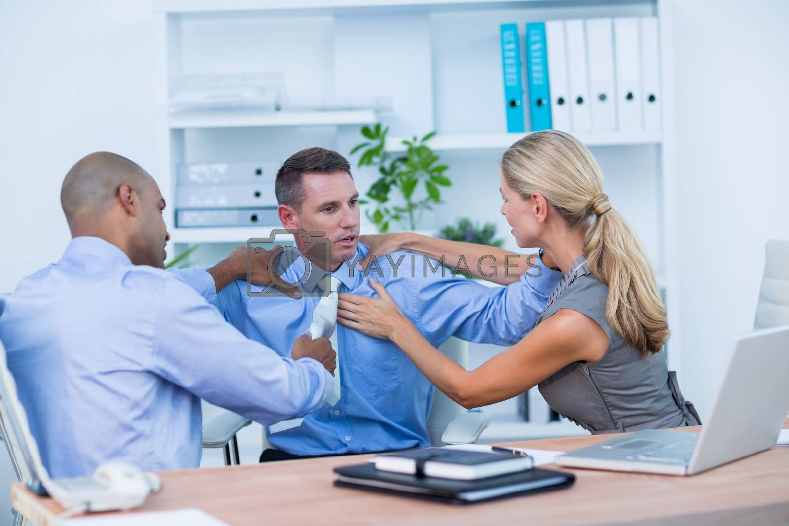Royalty free image of Business partners fighting together by Wavebreakmedia
