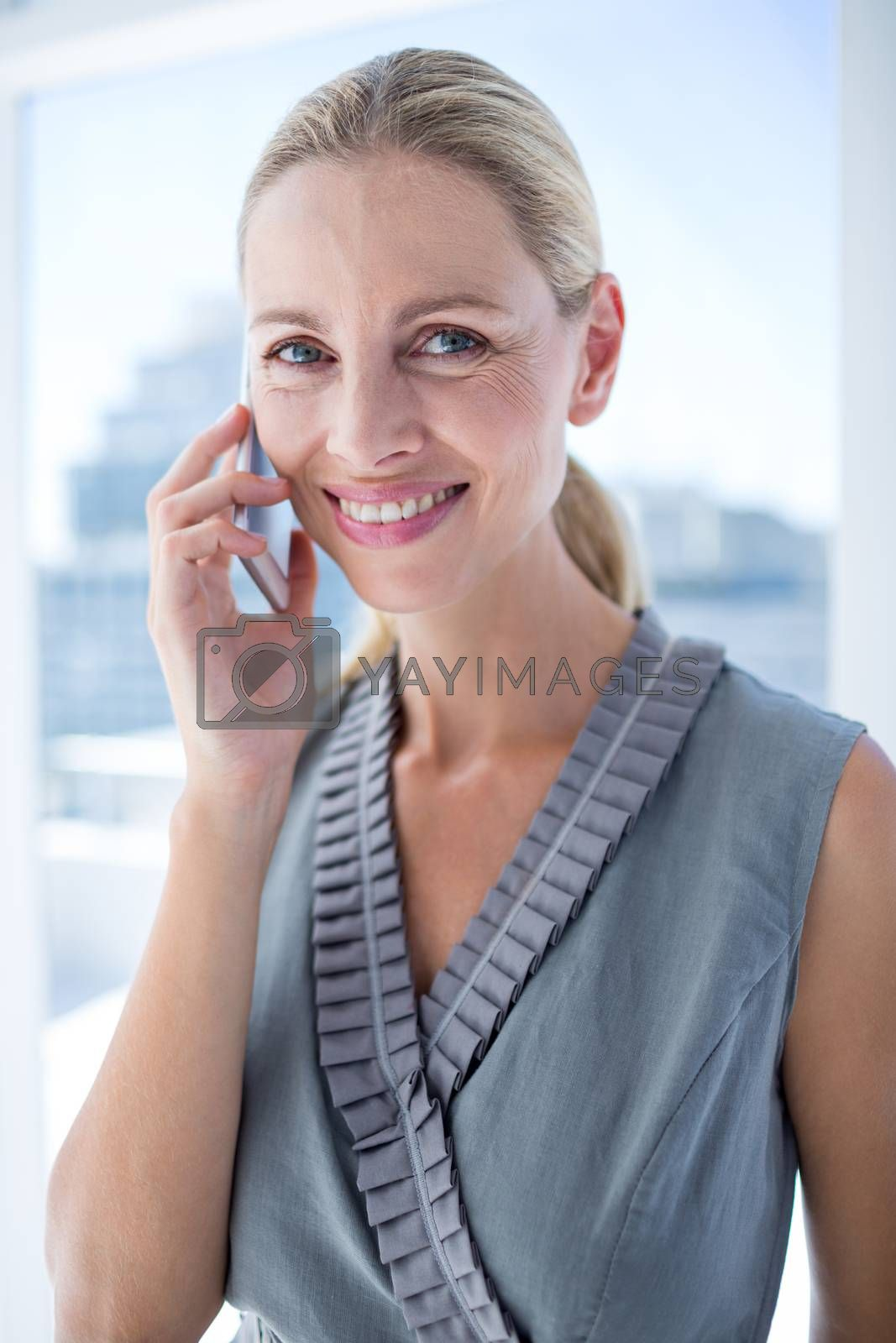 Royalty free image of Smiling businesswoman on the phone by Wavebreakmedia