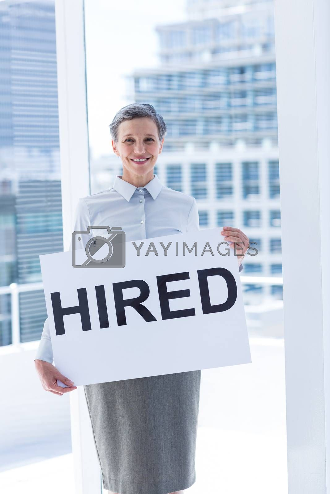 Royalty free image of Businesswoman holding a signboard hired by Wavebreakmedia