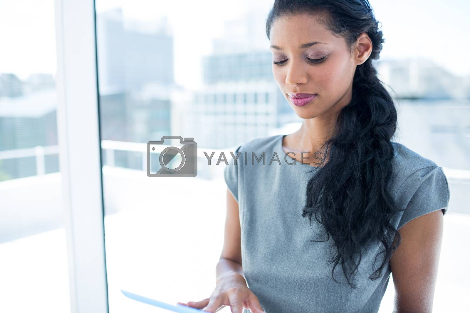 Royalty free image of A focused businesswoman using digital tablet by Wavebreakmedia
