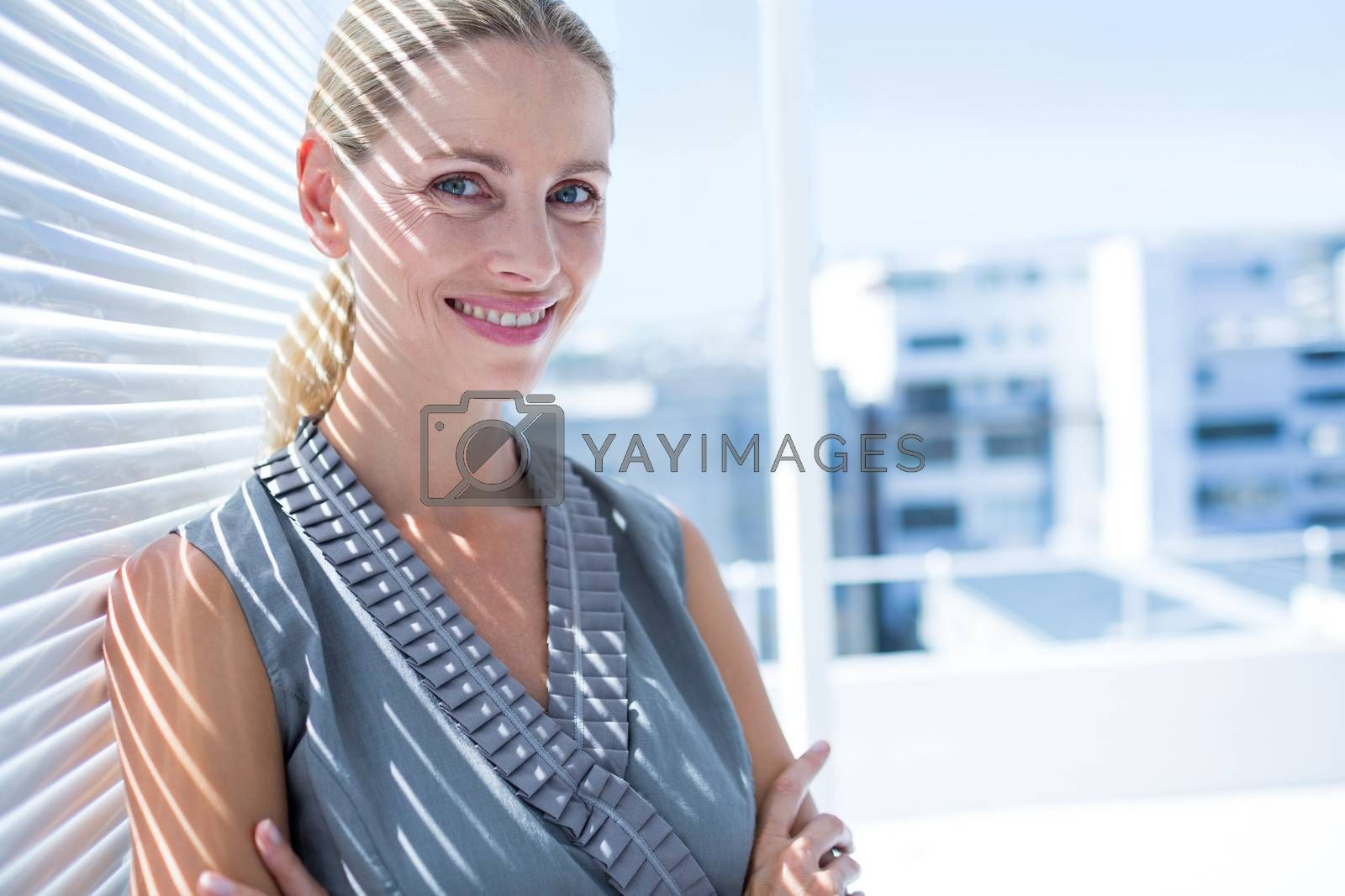 Royalty free image of Smiling businesswoman standing in the office by Wavebreakmedia