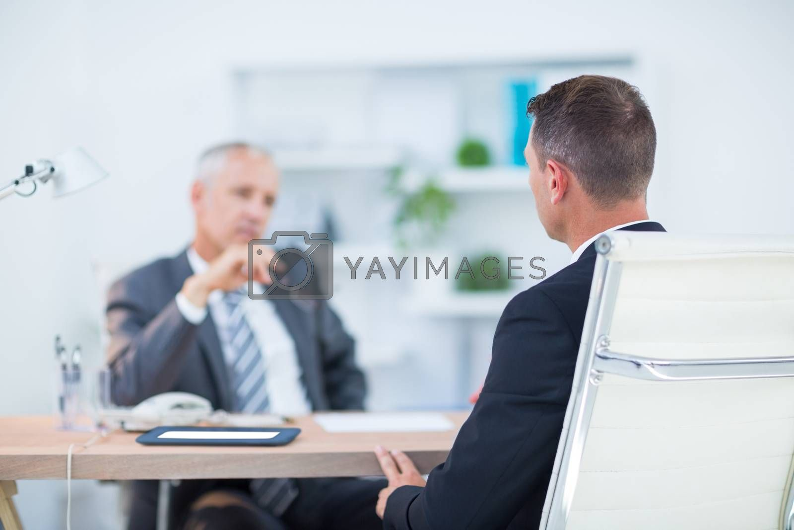 Royalty free image of Two businessmen sitting and speaking  by Wavebreakmedia