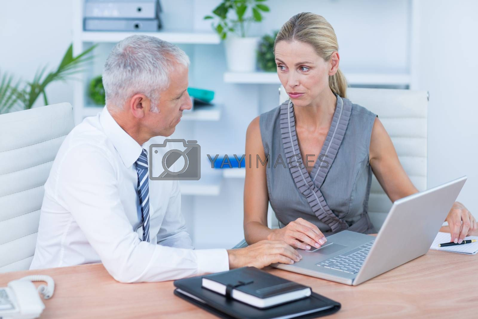 Royalty free image of Business people working at laptop  by Wavebreakmedia