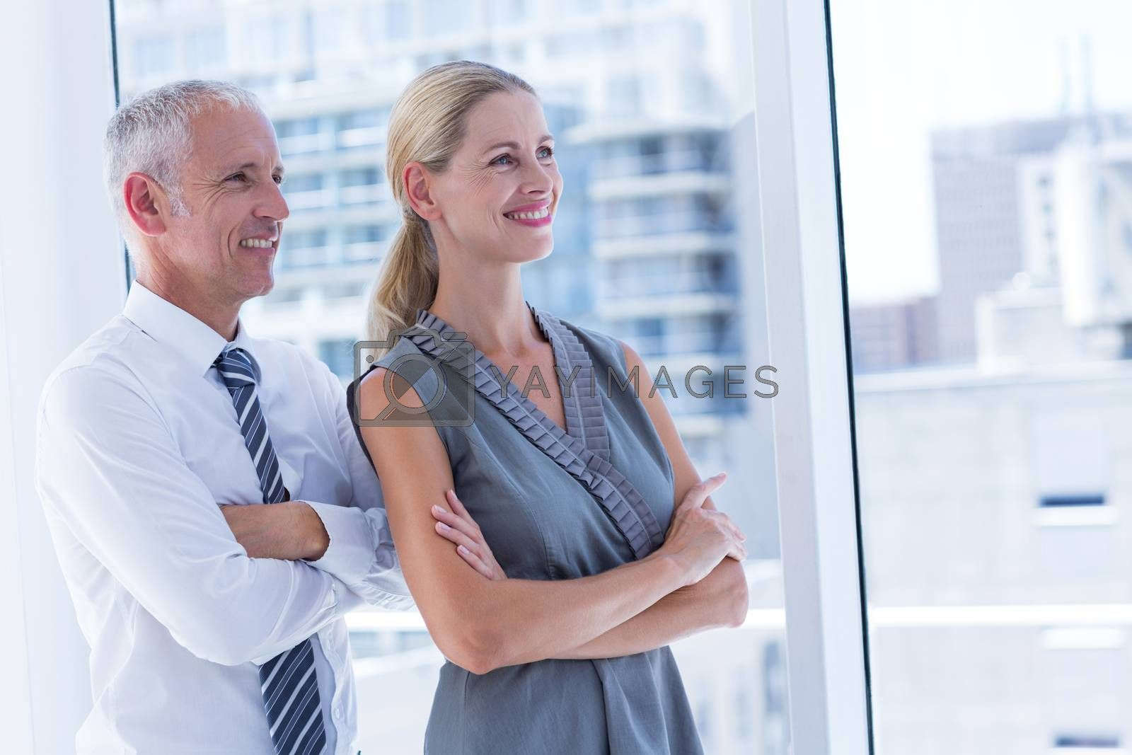 Royalty free image of Two smiling business people looking away by Wavebreakmedia