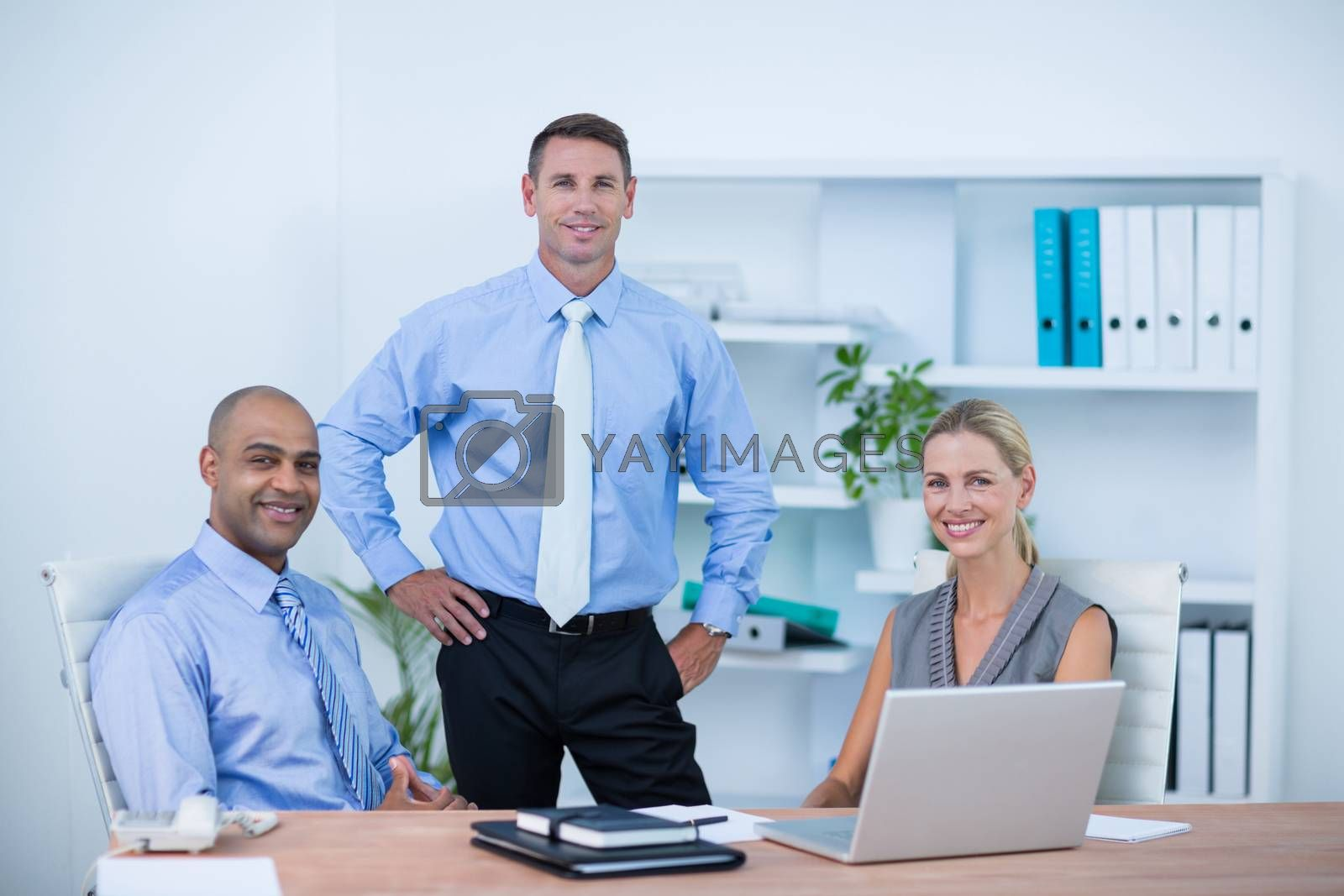 Royalty free image of Business partners smiling at camera by Wavebreakmedia