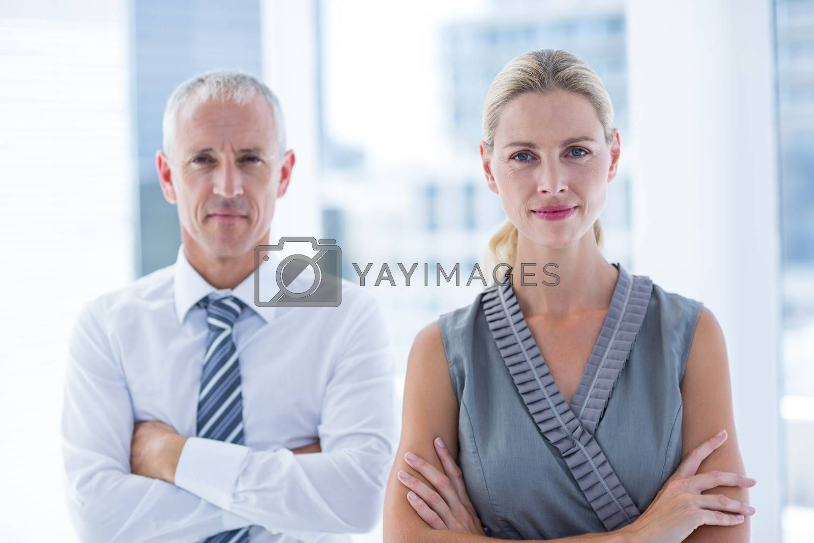 Royalty free image of Two business people looking at the camera by Wavebreakmedia