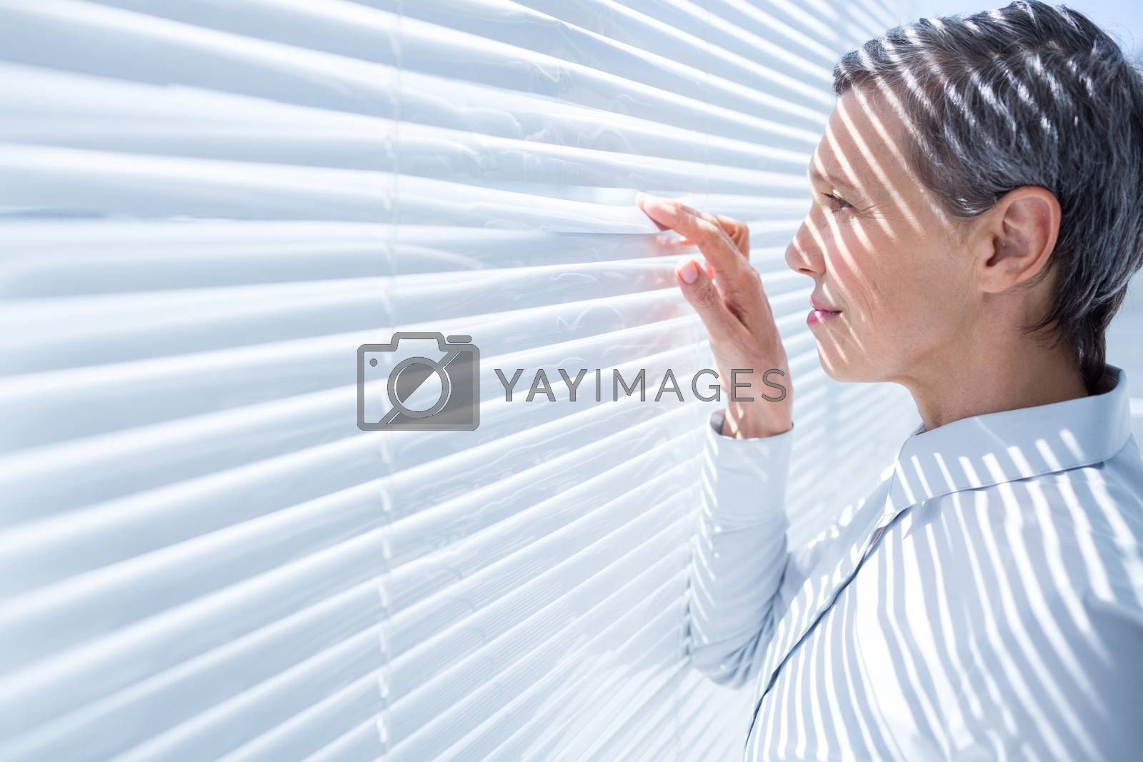 Royalty free image of Businesswoman looking through stores in the office by Wavebreakmedia