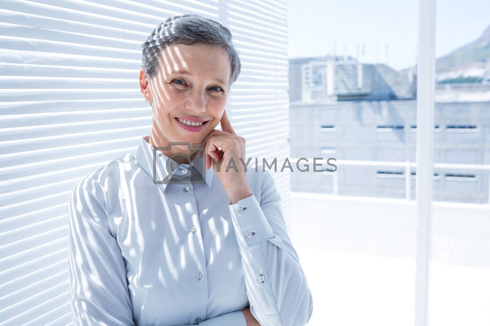 Royalty free image of Businesswoman looking at the camera with arms folded by Wavebreakmedia