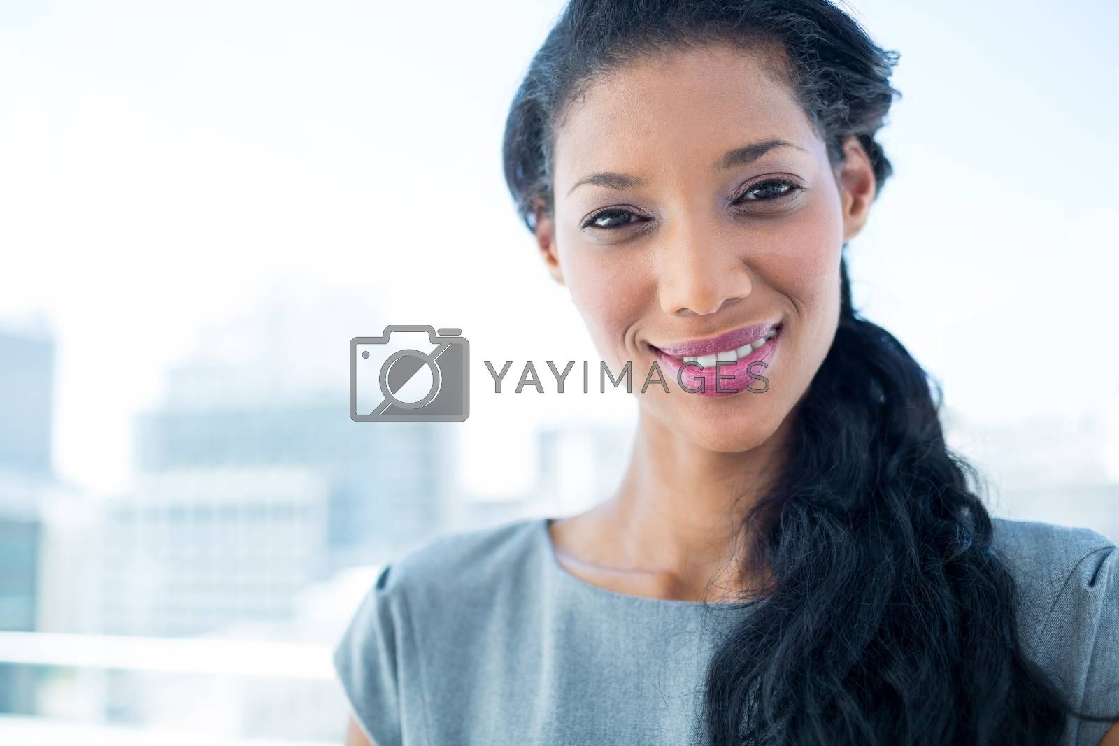 Royalty free image of Smiling businesswoman looking at camera by Wavebreakmedia