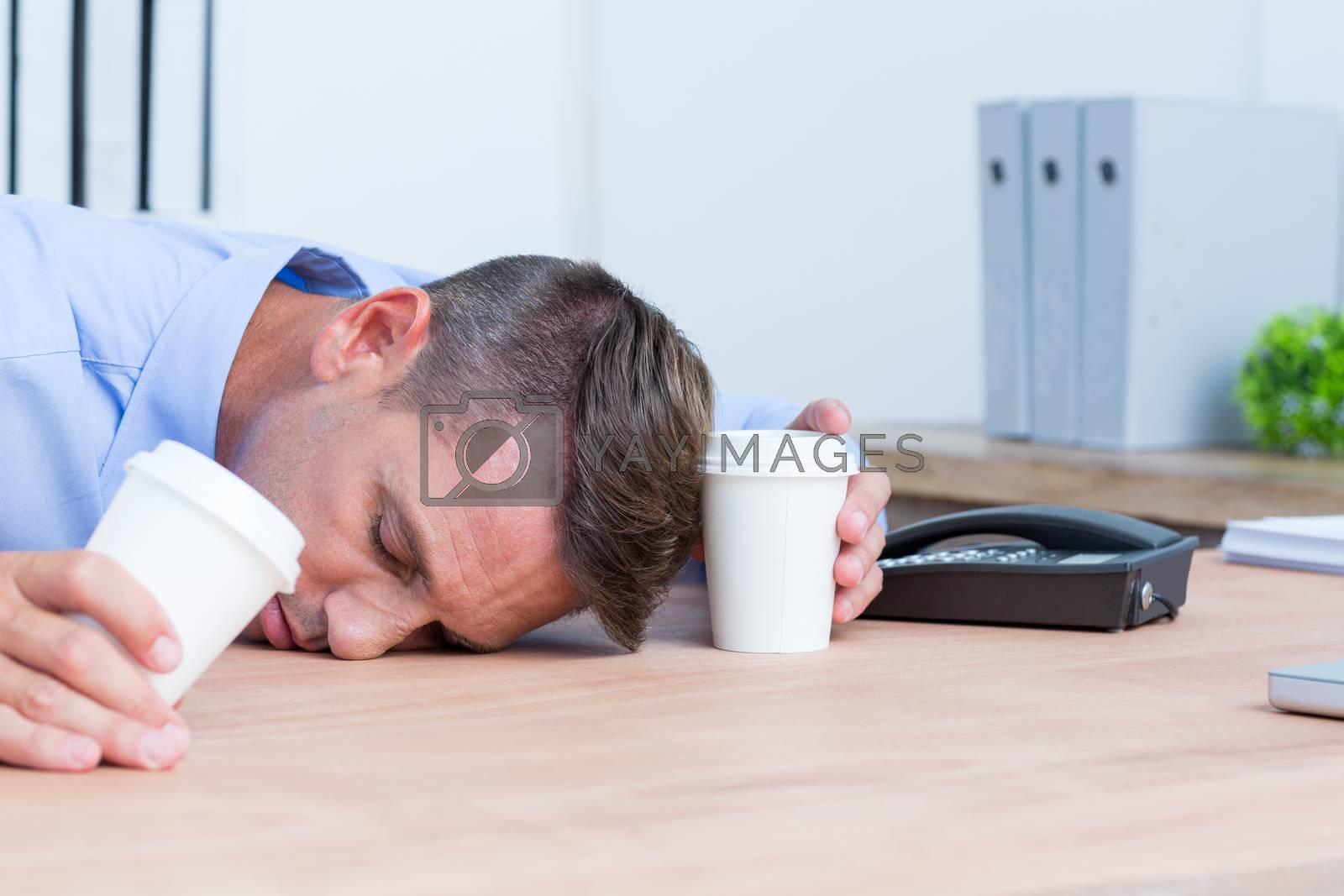 Royalty free image of Businessman sleeping on his desk by Wavebreakmedia