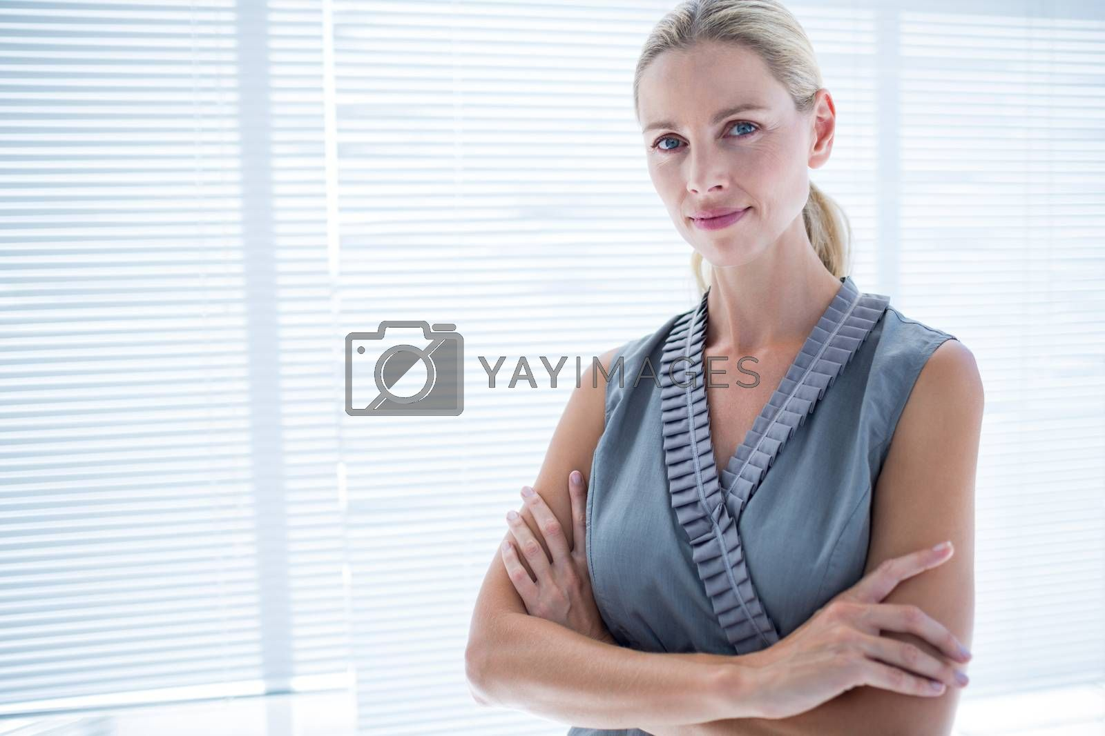 Royalty free image of Thoughtful businesswoman standing in the office by Wavebreakmedia