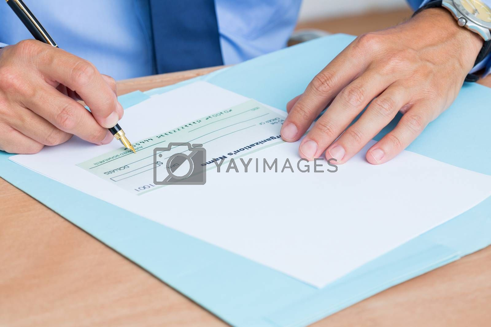 Royalty free image of Businessman writing a contrat before signing it by Wavebreakmedia