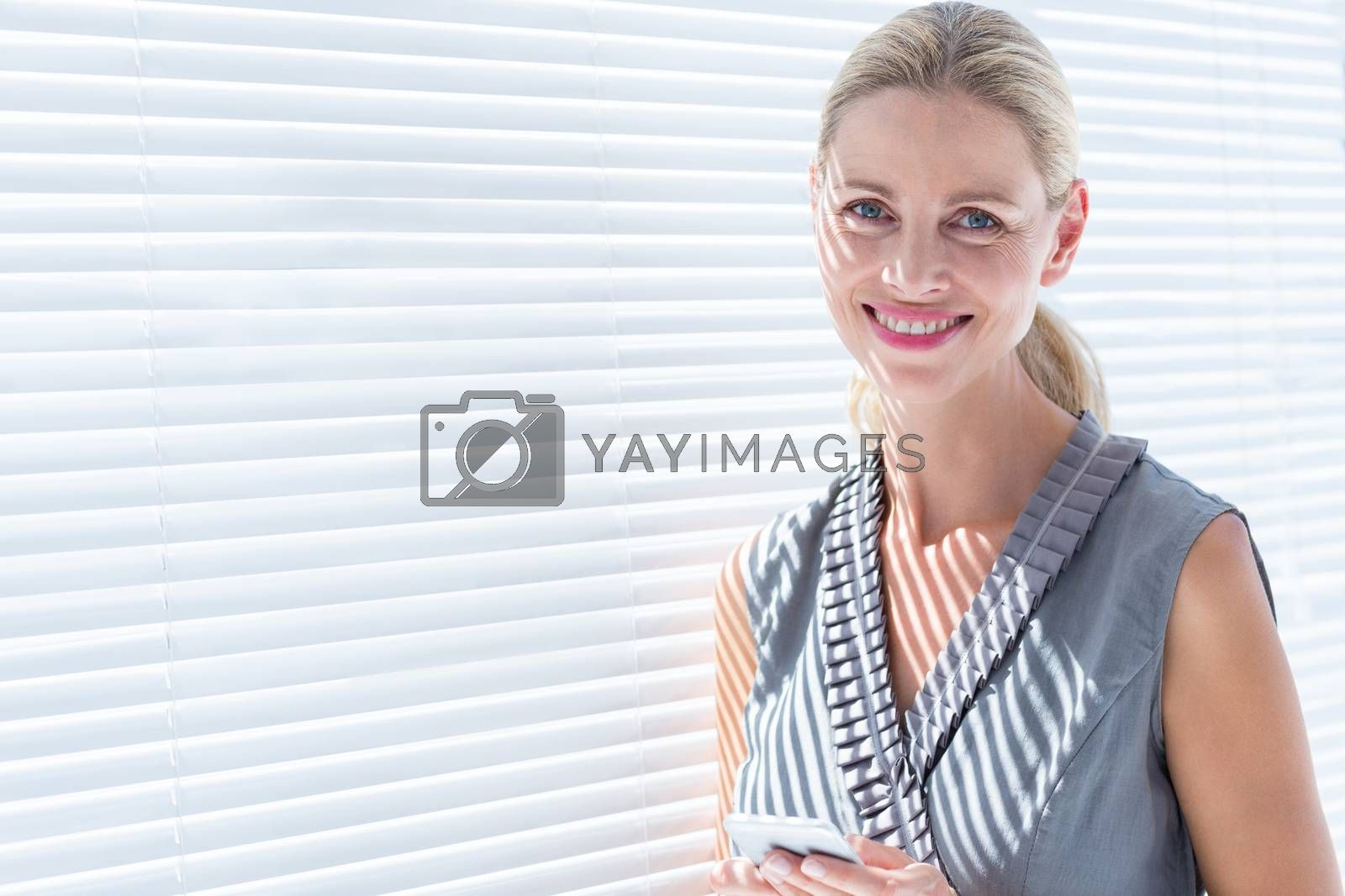 Royalty free image of Smiling businesswoman looking at the camera by Wavebreakmedia