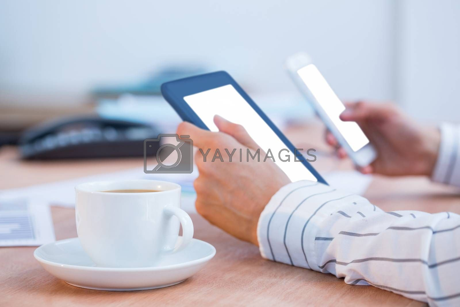 Royalty free image of Businesswoman using two digital tablet  by Wavebreakmedia