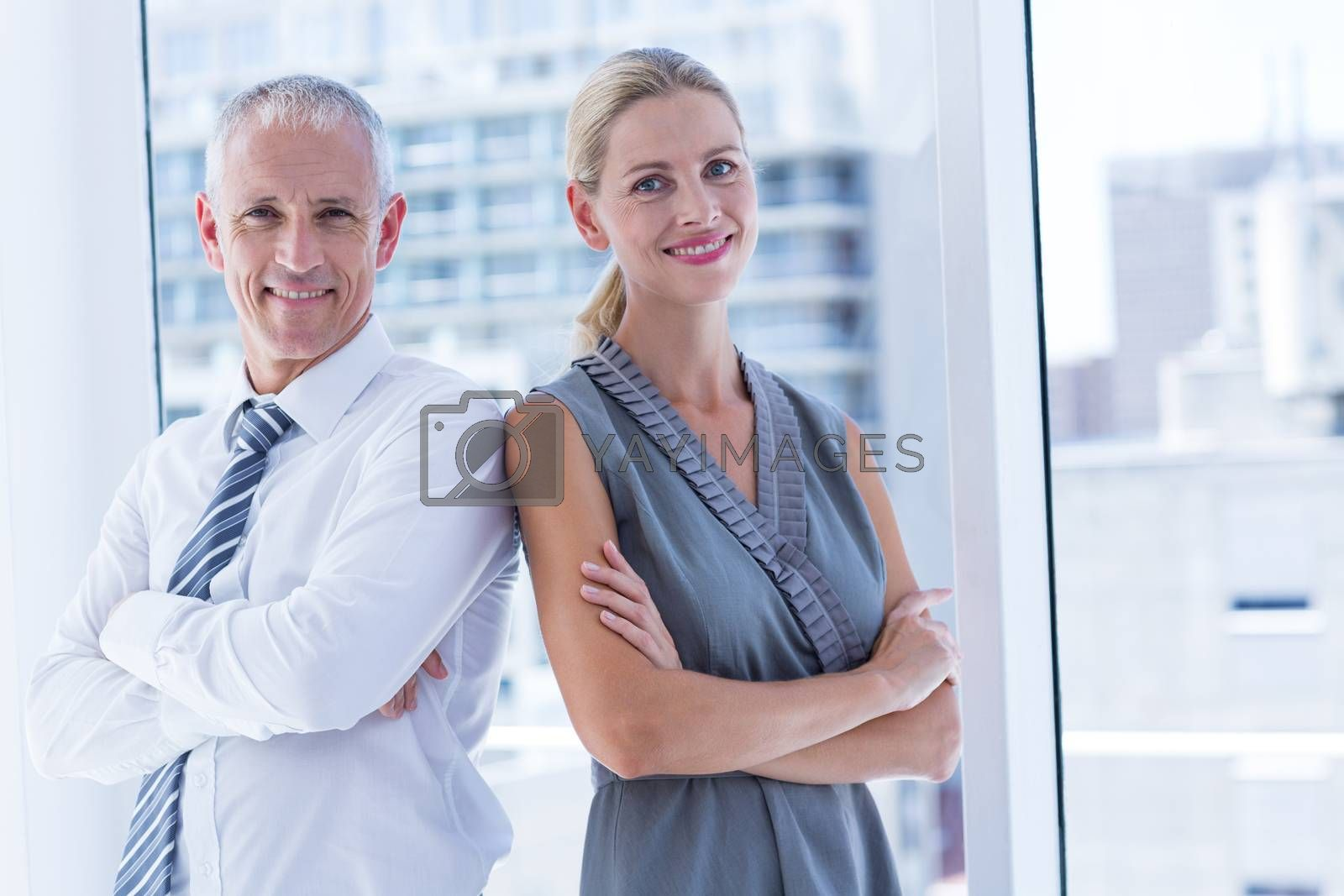 Royalty free image of Two business people smiling at the camera in the office by Wavebreakmedia