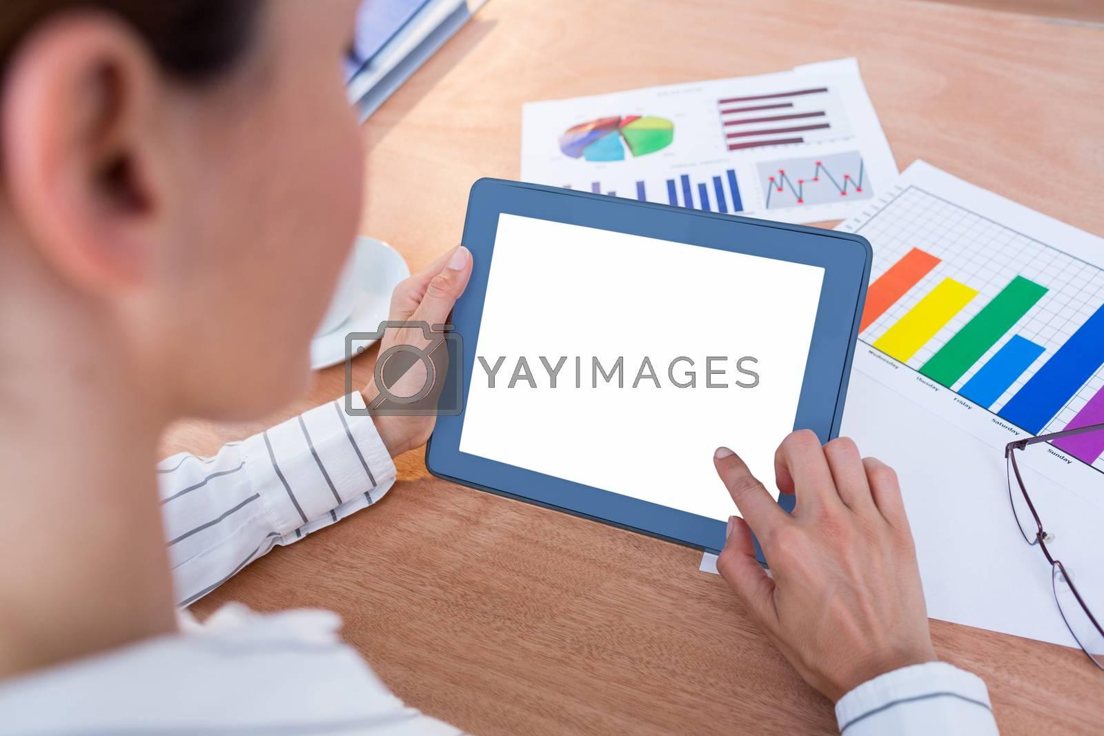Royalty free image of Businesswoman using her digital tablet by Wavebreakmedia